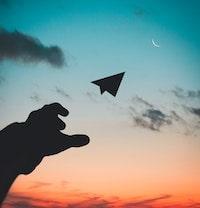 airplane-backlit-clouds-1262304-min.jpg